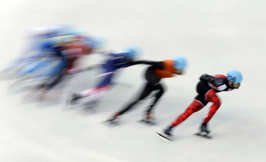 Canada's Francois Hamelin leads a pack of skaters around a turn during a men's 1500m short track speedskating race at the 2014 Winter Olympics, Monday, Feb. 10, 2014, in Sochi, Russia. Photo: Morry Gash, Associated Press