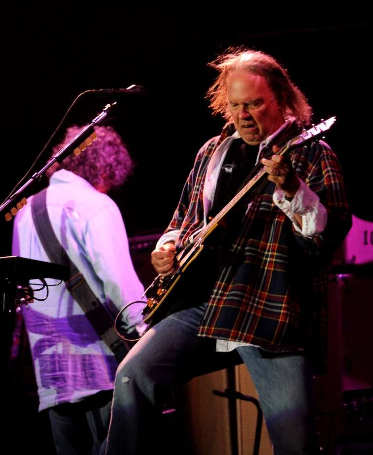 San Mateo County resident and rocker Neil Young is behind the Bay Area's annual Bridge School Benefit Concert. Pictured: Young performs during the 2012 Outside Lands Music Festival at Golden Gate Park on August 10, 2012 in San Francisco, California.  (Photo by C Flanigan/WireImage) Photo: C Flanigan, WireImage
