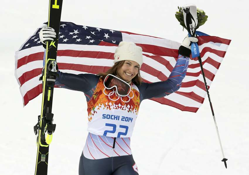 Women's supercombined bronze medalist United States' Julia Mancuso poses with the U.S. flag after a flower ceremony at the Alpine ski venue in the Sochi 2014 Winter Olympics, Monday, Feb. 10, 2014, in Krasnaya Polyana, Russia.