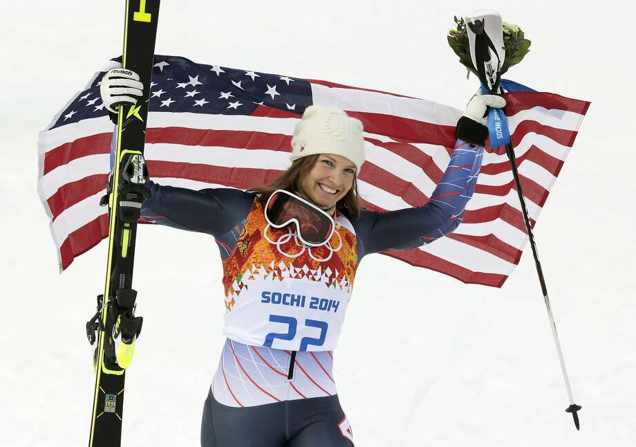 Women's supercombined bronze medalist United States' Julia Mancuso poses with the U.S. flag after a flower ceremony at the Alpine ski venue in the Sochi 2014 Winter Olympics, Monday, Feb. 10, 2014, in Krasnaya Polyana, Russia. Photo: Charles Krupa, Associated Press