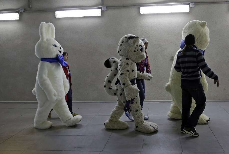 Mascots of the 2014 Winter Olympics walk out to the stadium prior to the start of the men's 500-meter speedskating race at the Adler Arena Skating Center in Sochi, Russia, Monday, Feb. 10, 2014. Photo: Matt Dunham, Associated Press