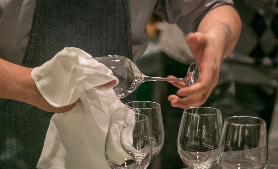 Glasses being polished at Alta CA in San Francisco. Photo: John Storey, Special To The Chronicle