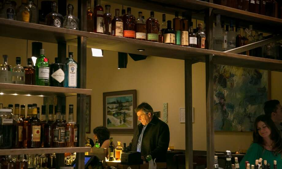 A man has a drink at the bar at Alta CA in San Francisco. Photo: John Storey, Special To The Chronicle