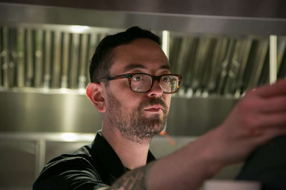 Chef Yoni Levy looks at tickets at Alta CA in San Francisco. Photo: John Storey, Special To The Chronicle