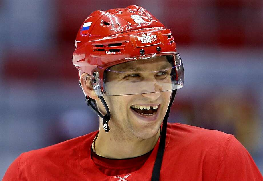 Russia forward Alexander Ovechkin laughs with teammates during a training session at the 2014 Winter Olympics, Monday, Feb. 10, 2014, in Sochi, Russia. Photo: Julie Jacobson, Associated Press