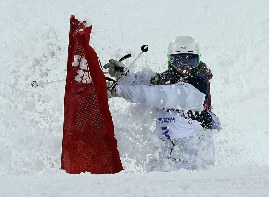 Patrick Deneen of the United States hits a flag during the men's moguls qualifying at the Rosa Khutor Extreme Park at the 2014 Winter Olympics, Monday, Feb. 10, 2014, in Krasnaya Polyana, Russia.  Photo: Andy Wong, Associated Press