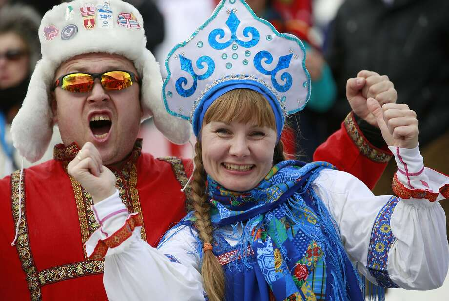 Russian fans react before the start of women's super combined slalom at the Sochi 2014 Winter Olympics, Monday, Feb. 10, 2014, in Krasnaya Polyana, Russia. Photo: Gero Breloer, Associated Press