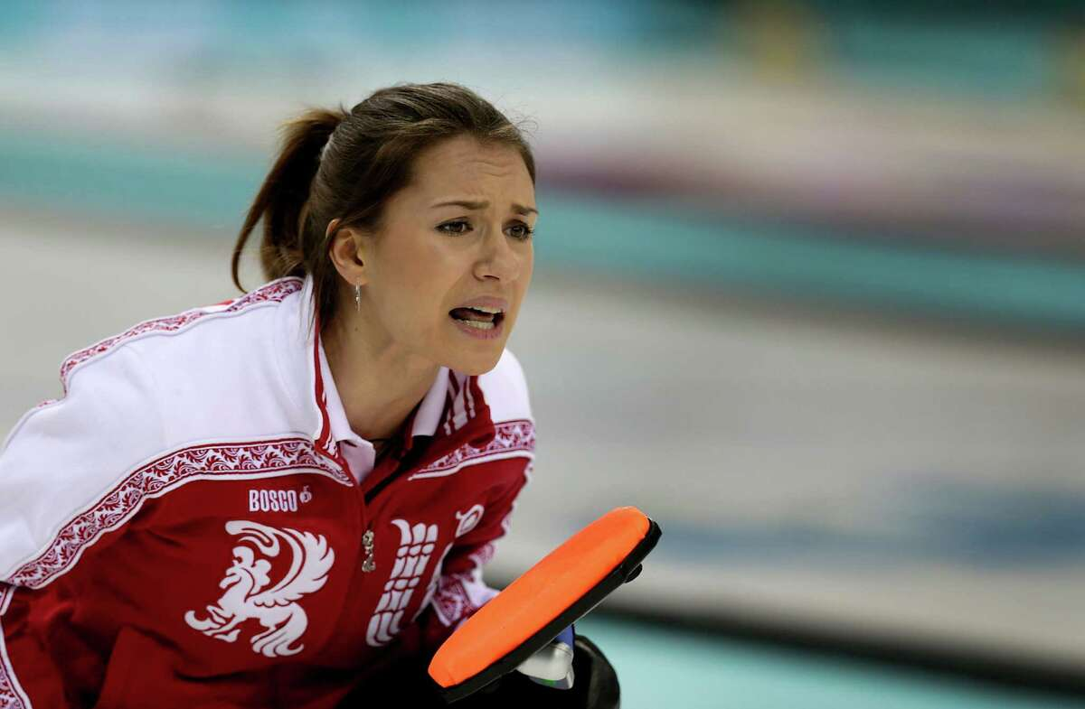 Russia's skip Alexandra Saitova shouts instructions to her teammates during the women's curling competition against Denmark at the 2014 Winter Olympics, Monday, Feb. 10, 2014, in Sochi, Russia.