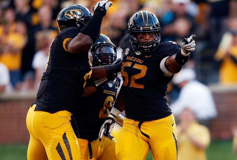 Michael Sam (52) was key leader of a Missouri team that reached the SEC title game in 2013. Photo: Jamie Squire, Getty Images