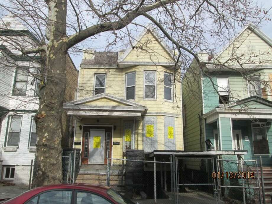 "Jersey City is being called among real estate industry professionals ""The New Brooklyn"" -- certainly it is cheaper than the old Brooklyn. This 6 bed, 2 bath REO lists at $129K. (Photos via RealtyTrac)"