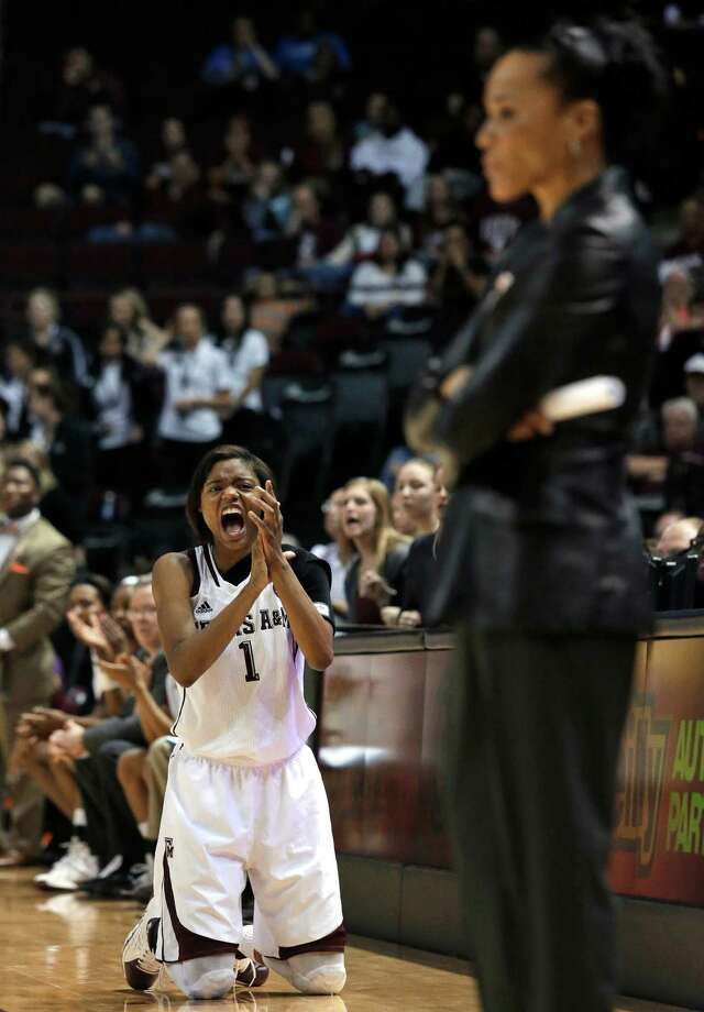 FILE: Texas A&M guard Courtney Williams (1) celebrates a score while South Carolina coach Dawn Staley stands in the foreground during the second half of an NCAA college basketball game, Thursday, Jan. 16, 2014, in College Station, Texas. Texas A&M defeated South Carolina 67-65 in overtime.  (AP Photo/Patric Schneider) Photo: Patric Schneider, Associated Press / FR170473 AP