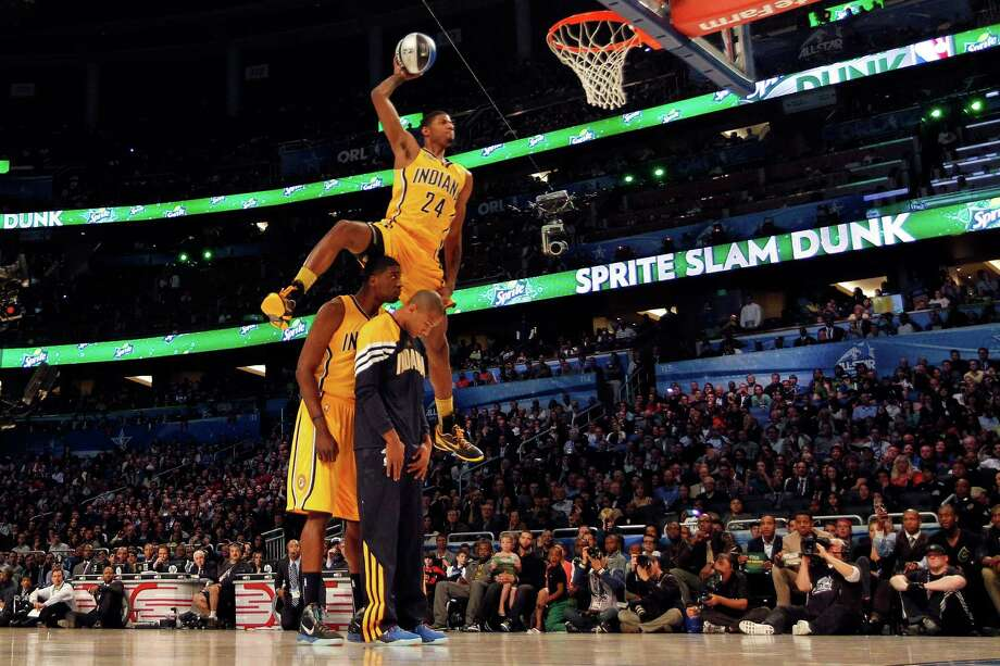 Paul George of the Indiana Pacers jumps over pacers teammates Roy Hibbert and Dahntay Jones as he dunks during the Sprite Slam Dunk Contest part of 2012 NBA All-Star Weekend at Amway Center on February 25, 2012 in Orlando, Florida. Photo: Mike Ehrmann, Getty Images / 2012 Getty Images