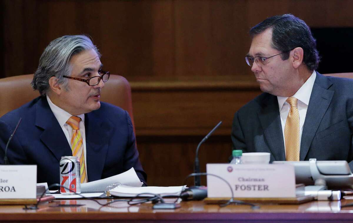 University of Texas System Chancellor Dr. Francisco Cigarroa, left, talks to UT System Board of Regents Chairman Paul Foster, right.