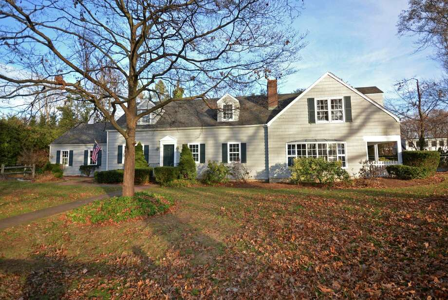 The 11-room expanded Cape Cod at 18 Seagate Road in Darien fronts Holly Pond. It is on the market for $1,599,000. Photo: Contributed Photo, Contributed / Darien News