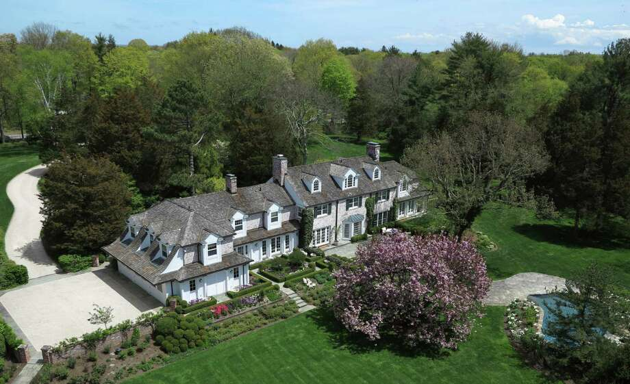 The 12-room Colonial at 1024 Smith Ridge Road in New Canaan sits on more than 4 acres and is surrounded by a buffer of trees. It is on the market for $4,500,000. Photo: Contributed Photo, Contributed / New Canaan News Contributed