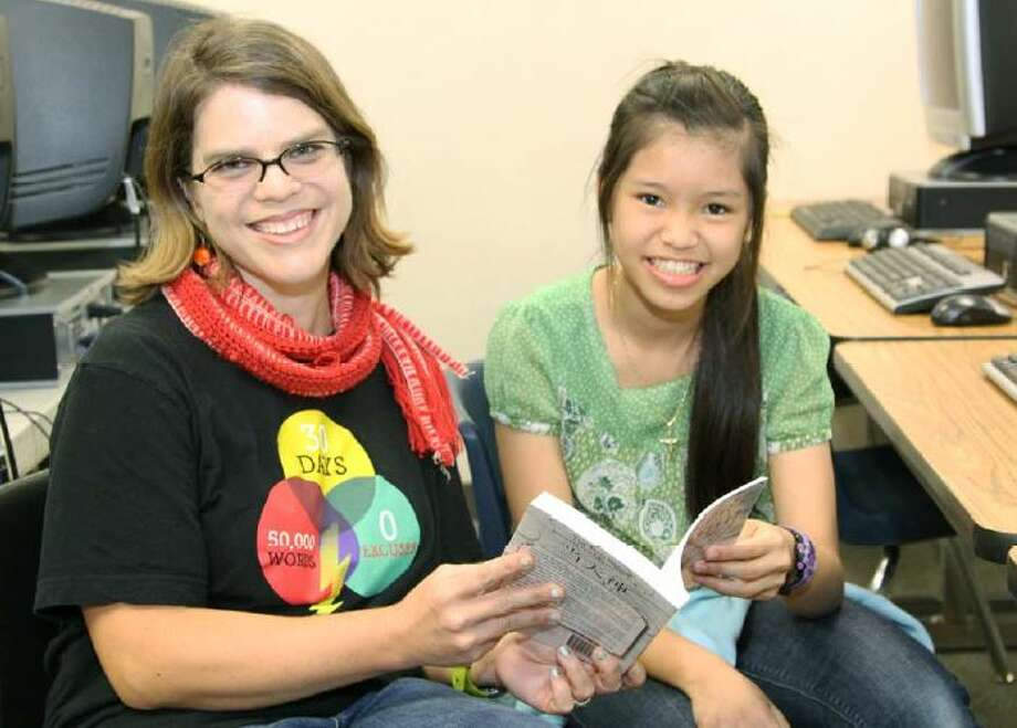 """Author D. Marie Prokop shares her book """"The Red String"""" with Northpointe Intermediate School sixth-grade student T-Quyen Pham. Photo: Courtesy Of Northpointe Intermediate School"""