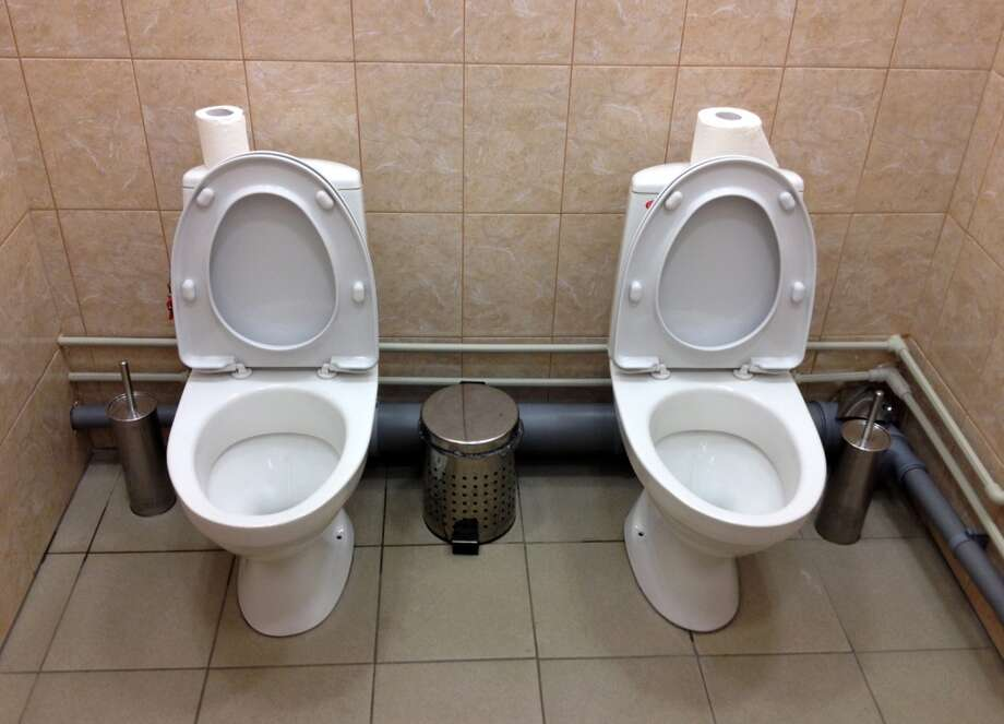 Side-by-side toilets in a single bathroom caused a sensation last month when they were discovered at the biathlon course of the Sochi Olympics, swiftly becoming a national joke in Russia. The Sochi organizing committee initially denied knowledge of the second twin toilet, and it has not been able to say whether the loo-loo was built by design or resulted from an error during the plumbing process. (AP Photo) Photo: Associated Press