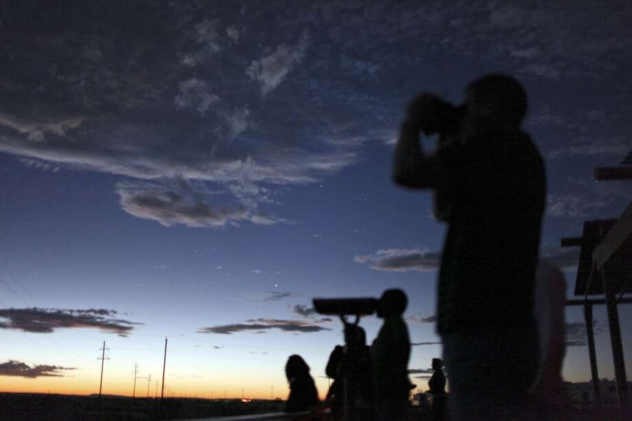 People look for the Marfa lights Oct. 20, 2012, at the Marfa Lights Viewing Area, just east of Marfa. Photo: Edward A. Ornelas, San Antonio Express-News