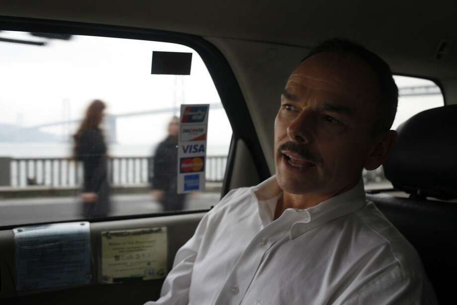 Steve Humphreys, CEO of Flywheel Software Inc. rides down the Embarcadero in a taxi cab, Thursday February 6, 2014, in San Francisco, Calif. Photo: Lacy Atkins, The Chronicle