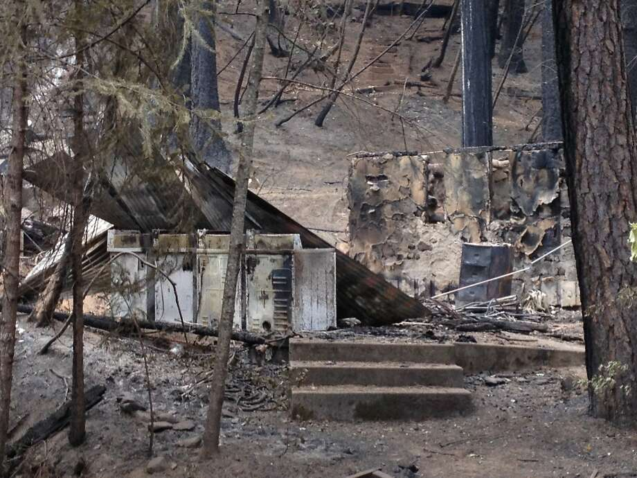 The remains of a building housing laundry machines is seen at the city of Berkeley's Tuolumne Family Camp on Sept. 4, 2013, about two weeks after the Rim Fire burned through the region. Photo: Courtesy Of William Rogers