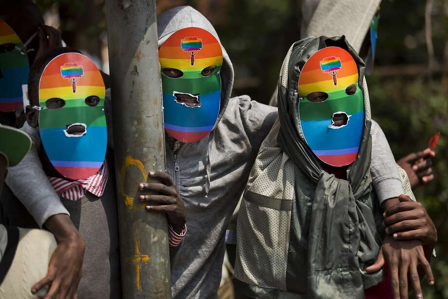 Demonstrators in Nairobi, Kenya, wear rainbow masks to protect their identities as they rally against harsh antigay legislation now being considered for the president's approval in neighboring Uganda. Photo: Ben Curtis, Associated Press