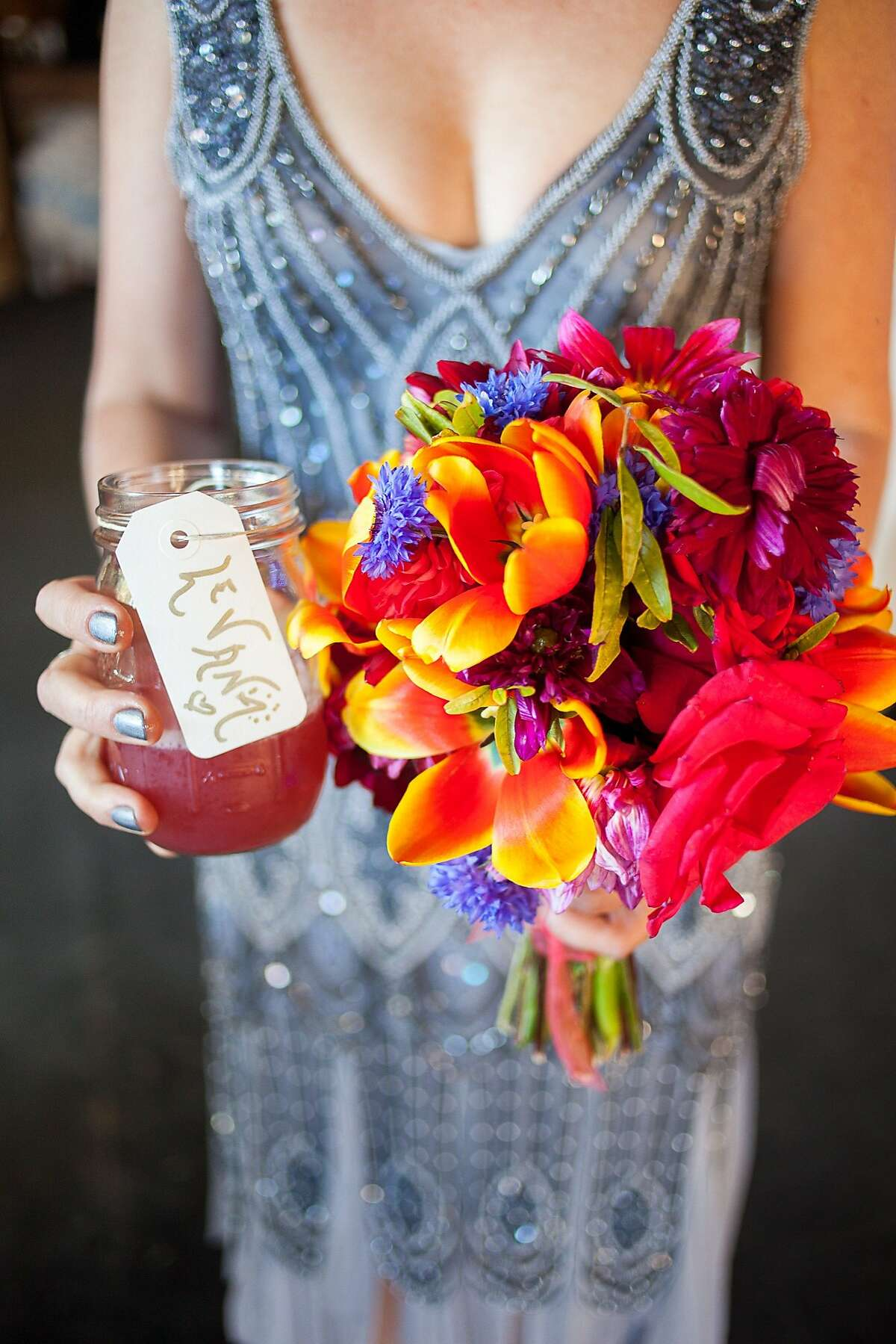 San Francisco couple Levana Saxon and Casey Harrell married Sept. 28 on a private piece of land in Sebastopol. The local and pesticide-free flowers were arranged by her friends.