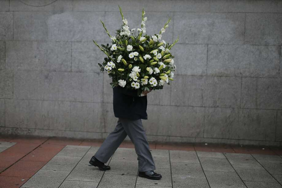 Bundle of blooms: In Madrid, a bouquet of flowers stretches its legs. Photo: Andres Kudacki, Associated Press