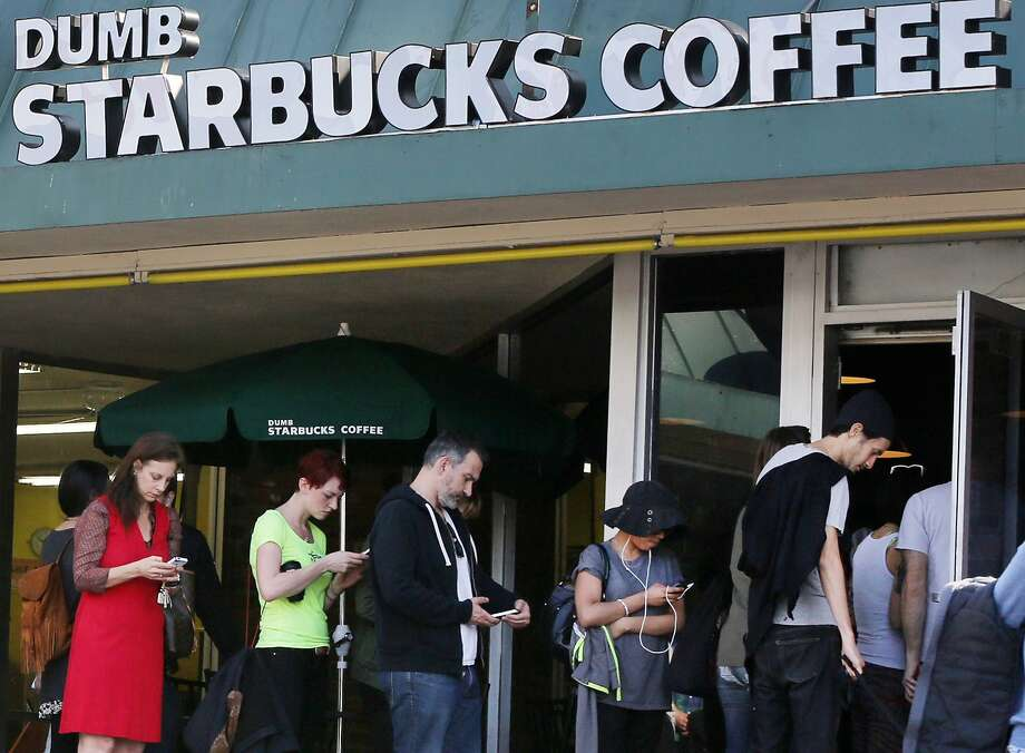 "People line up to get their fix at the strip mall site. Descriptions of the coffee ranged from ""horrible"" to ""bitter."" ""While we appreciate the humor, they cannot use our name,"" Starbucks said of Dumb Starbucks. Photo: Damian Dovarganes, Associated Press"