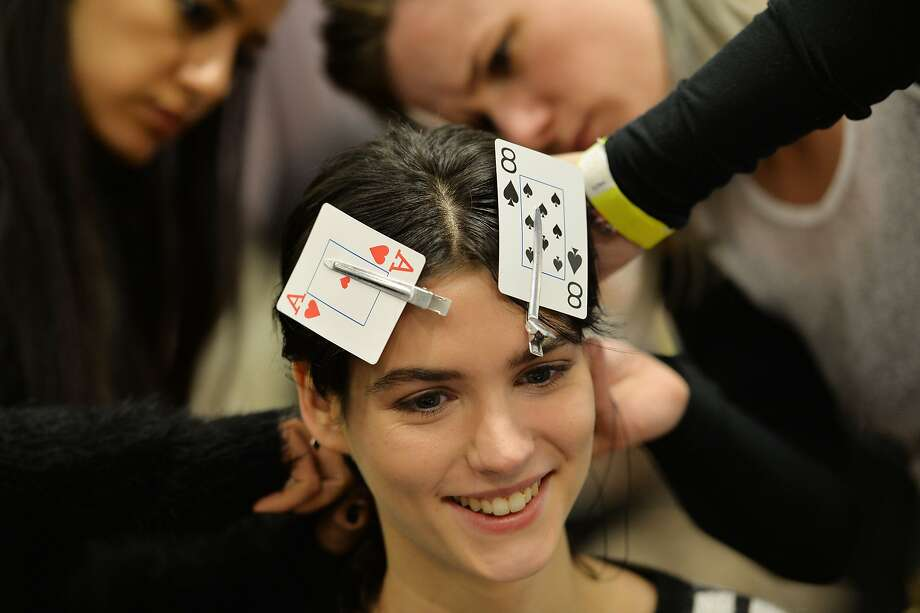 Poker-faced:Stylists deal with a few loose ends before the Yigal Azrouel show at Mercedes-Benz Fashion Week in New York. Photo: Stan Honda, AFP/Getty Images