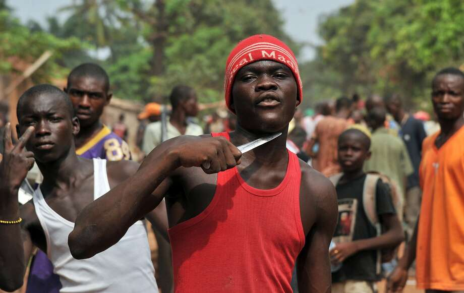 A man holding a knife to his throat says he is looking for Muslims in order to cut off 