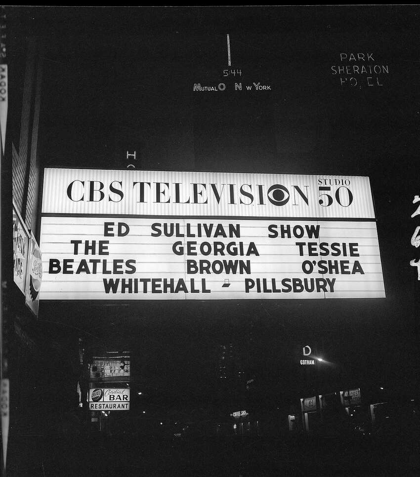 'The Ed Sullivan Show' marquee outside of CBS's Studio 50 in New York City lists the show's headlining acts.