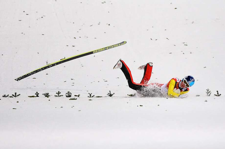 The agony of defeat:Severin Freund of Germany wipes out during the 