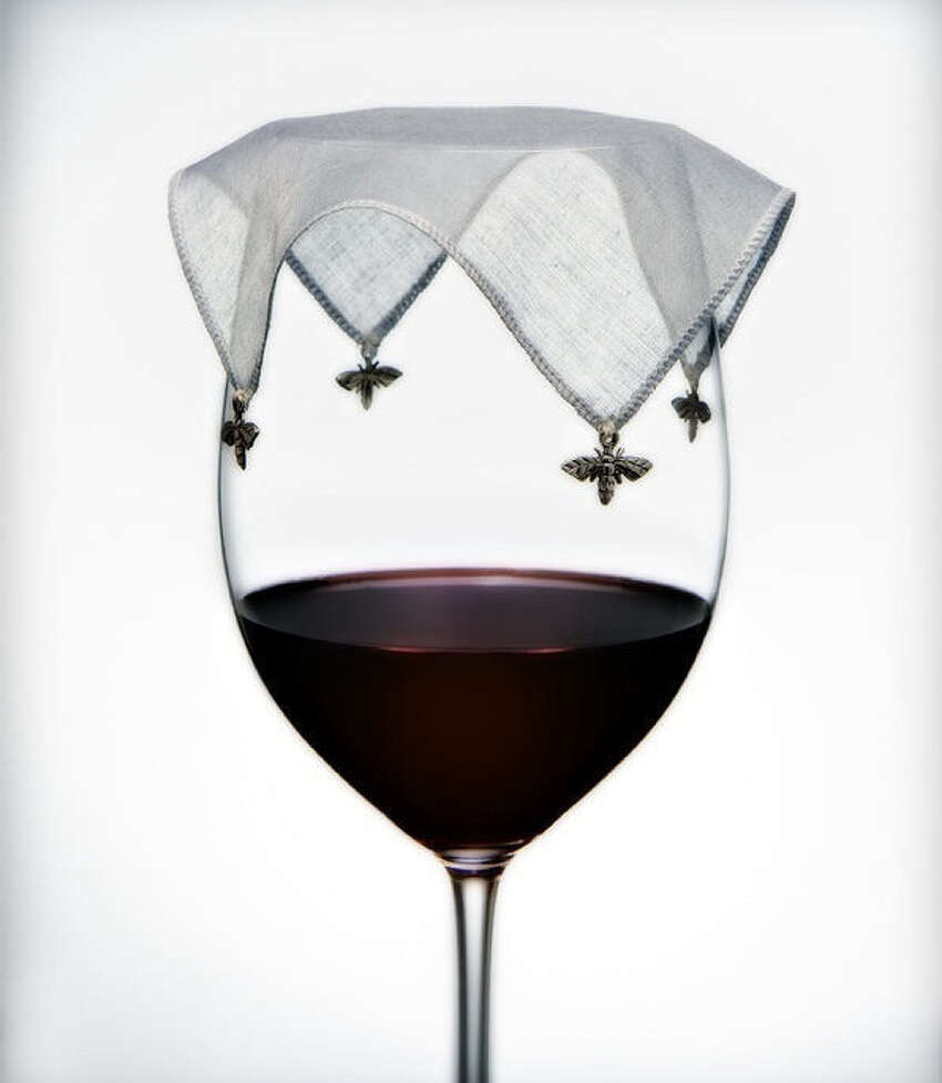 Don't forget the Wine Veils sold at Shades of Green nursery to keep the gnats, fruit flies and other annoying insects from dive-bombing her beverage while outdoors.