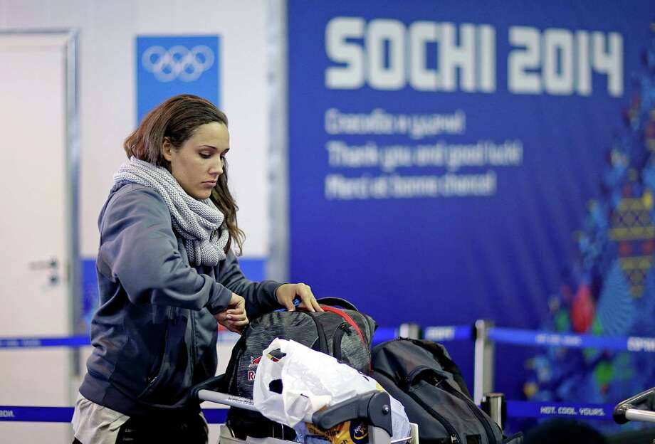 """FILE - In this Jan. 30, 2014, file photo, United States bobsled brakeman Lolo Jones arrives at the 2014 Winter Olympics in Sochi, Russia. Jones has gotten ill at the Sochi Olympics. Jones tweeted Monday, Feb. 10, 2014,  that she was in a """"quarantine room"""" in the village. U.S. bobsled spokeswoman Amanda Bird confirmed Jones exhibited cold and flu symptoms, and that the move was precautionary. Photo: David Goldman, AP / AP"""
