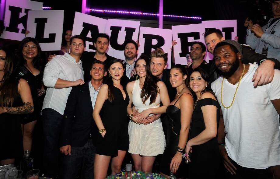 Singer Nick Carter (4th R) of the Backstreet Boys and his fiancee Lauren Kitt (5th R) celebrate their coed bachelor and bachelorette party at Ghostbar at the Palms Casino Resort on February 8, 2014 in Las Vegas, Nevada.  (Photo by David Becker/WireImage) Photo: David Becker, WireImage
