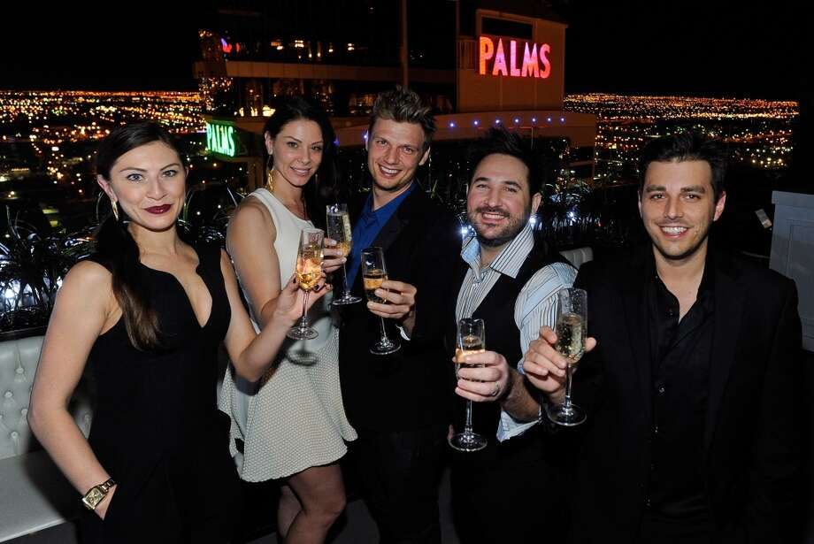 (L-R) Alexandra Kitt, Lauren Kitt, singer Nick Carter of the Backstreet Boys, Shadrick Ferrer and Chris Stensby celebrate Carter's and Lauren Kitt's coed bachelor and bachelorette party at Ghostbar at the Palms Casino Resort on February 8, 2014 in Las Vegas, Nevada.  (Photo by David Becker/WireImage) Photo: David Becker, WireImage