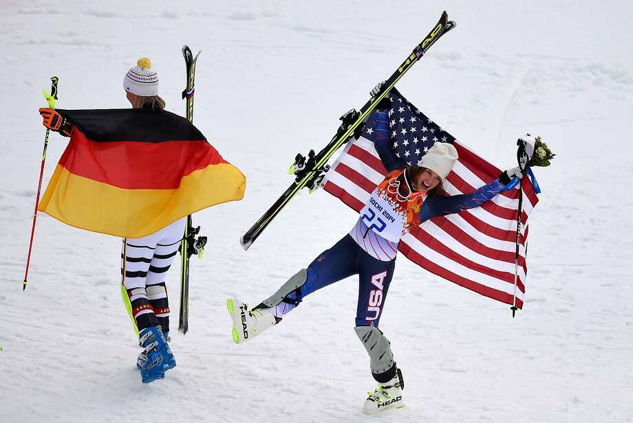U.S. skier Julia Mancuso, who won a bronze medal in the super-combined - her fourth career Olympic medal - celebrates near gold medalist Maria Hoefl-Riesch of Germany. Photo: Fabrice Coffrini, AFP/Getty Images