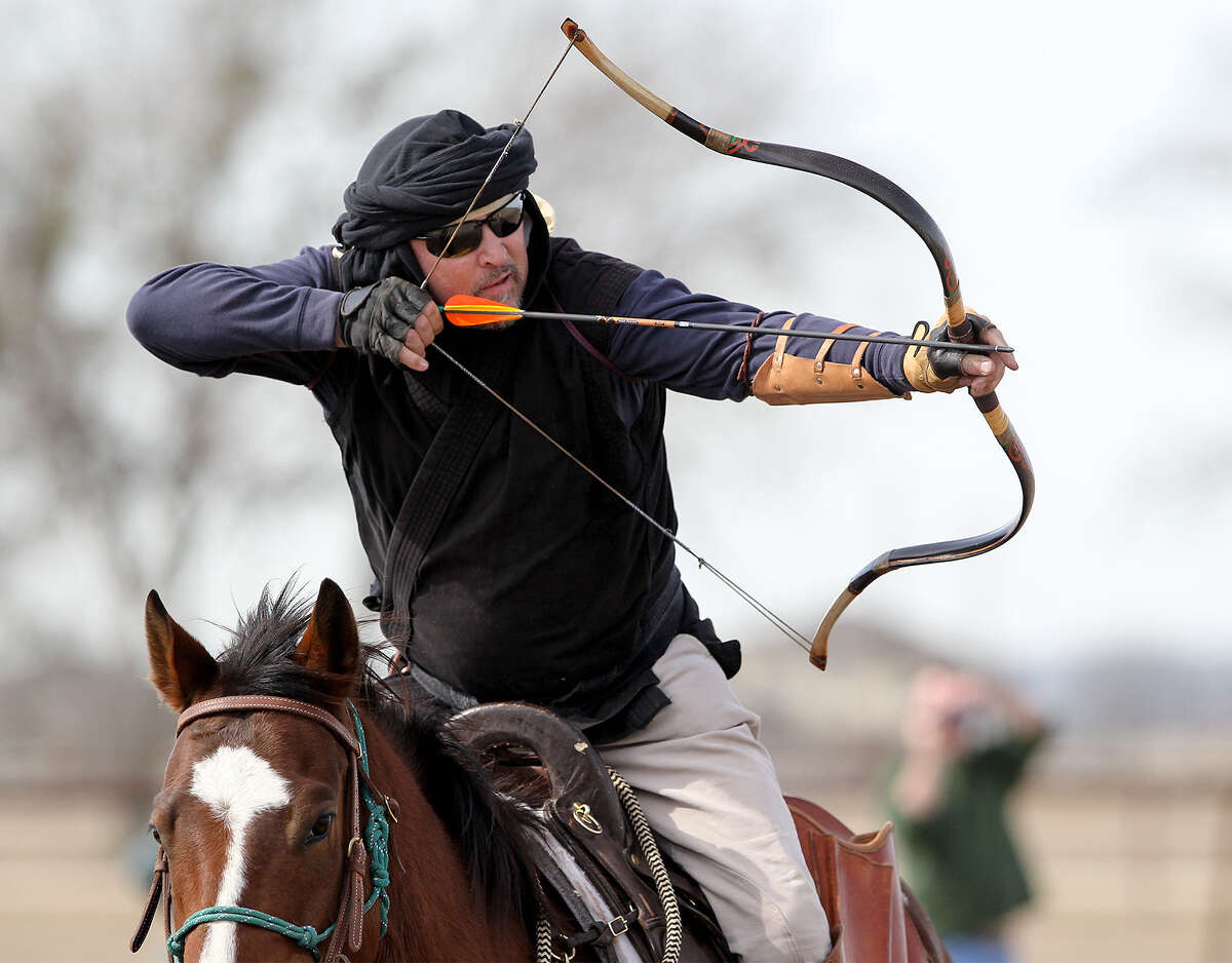 Todd Mathis of San Antonio's West Side prepares to shoot as his horse gallops past a target during a recent training session. He's a member of the A Company Mounted Archery from New Braunfels. Mounted archery, a centuries-old art, is growing in popularity.
