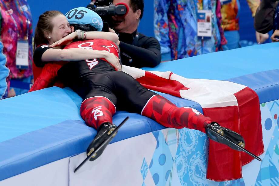 Charles Hamelin of Canada celebrates with Marianne St-Gelais after winning the short track skating 1,500 final. Photo: Matthew Stockman, Getty Images