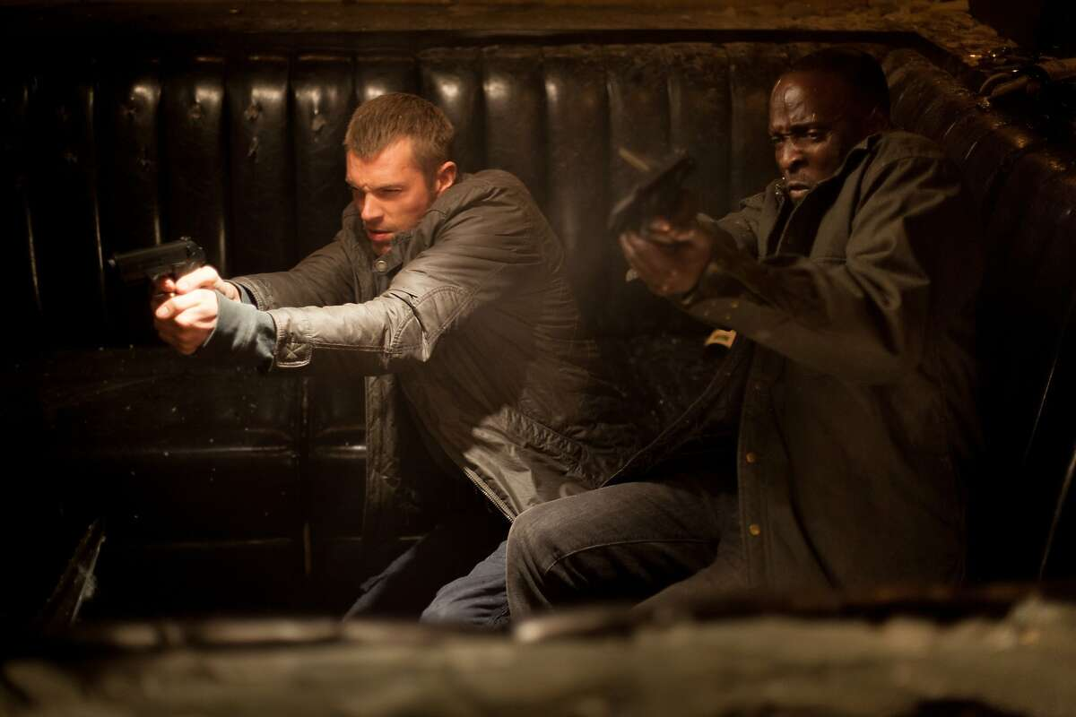 Joel Kinnaman and Michael K Williams star in Columbia Pictures'