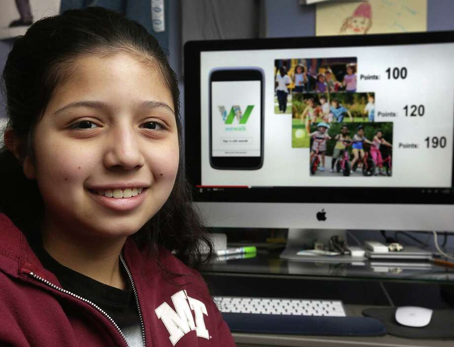Estrella Hernandez, 13, received $12,000 to develop a San Antonio-based fitness app called We Walk, where users can accumulate points for exercising and redeem then at local businesses. Photo: Bob Owen / San Antonio Express-News / © 2012 San Antonio Express-News