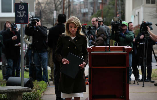 Texas Sen. Wendy Davis leaves a press conference after addressing the pending school finance lawsuit. Photo: Jerry Lara, San Antonio Express-News / ©2013 San Antonio Express-News