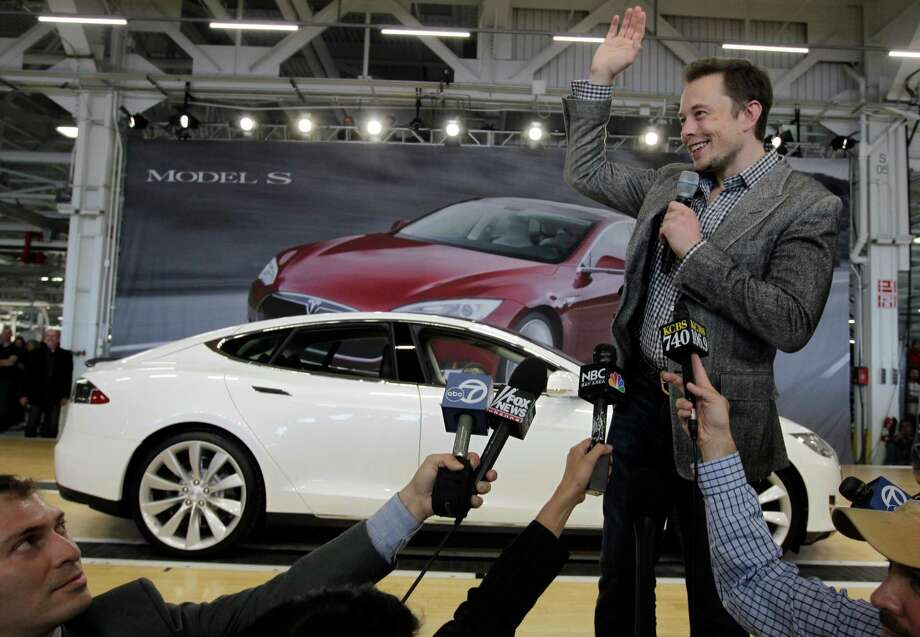 Tesla CEO Elon Musk waves during a rally at the Tesla factory in Fremont, Calif., Friday, June 22, 2012. The first mass-market sedans offered by electric car maker Tesla are now on the road. Photo: Paul Sakuma, Associated Press / AP