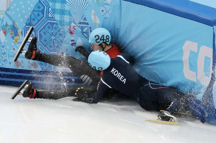 Sjinkie Knegt of Netherlands, back, and Park Se-Yeong of South Korea crash out in a men's 1500m short track speedskating final at the Iceberg Skating Palace during the 2014 Winter Olympics, Monday, Feb. 10, 2014, in Sochi, Russia. (AP Photo/Ivan Sekretarev) Photo: Ivan Sekretarev, Associated Press