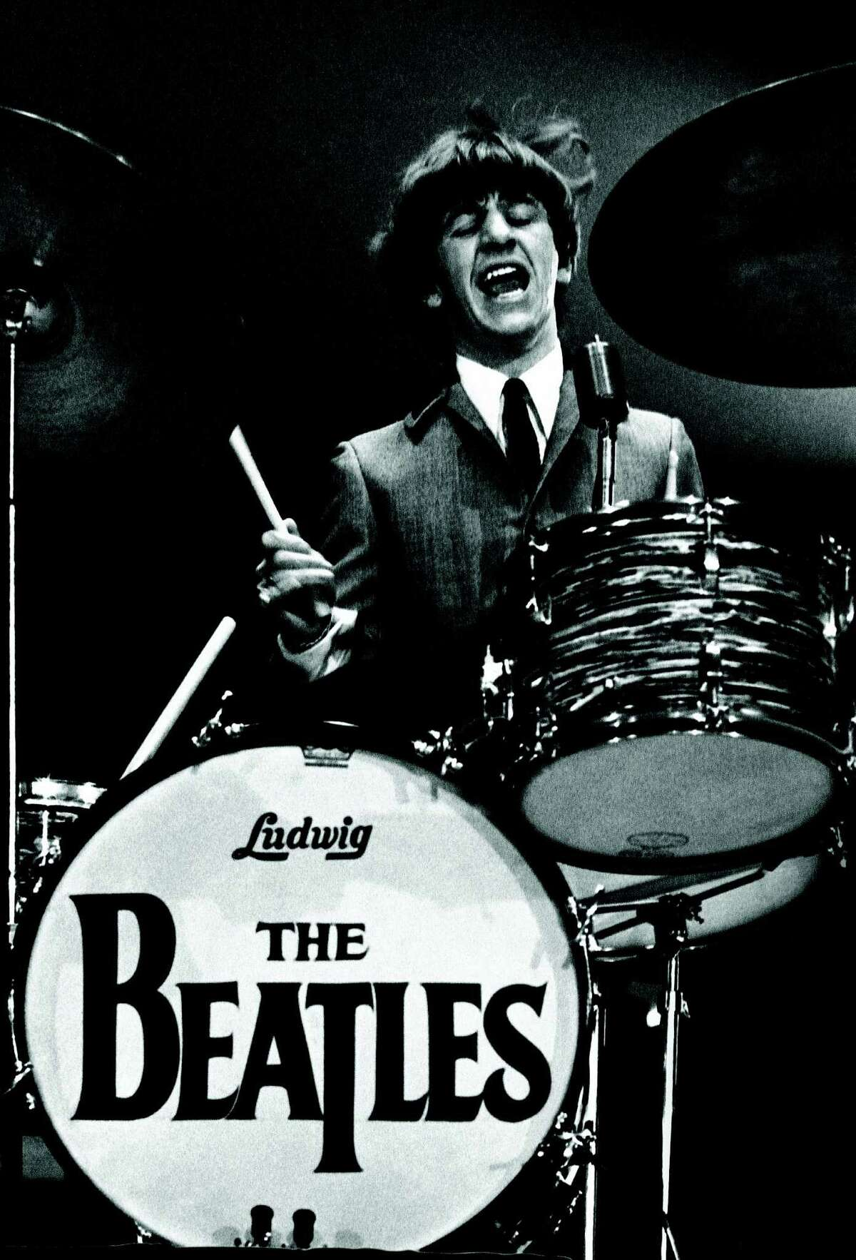 Ringo Starr plays drums at the Beatles' first U.S. concert on Feb. 11, 1964, at the Washington Coliseum. The concert took place in a boxing arena.