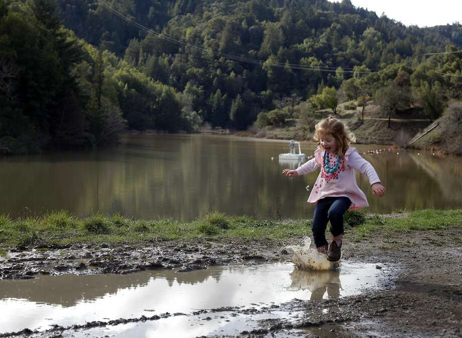Three-year-old Alexa Caselii jumps in puddles left by the recent storm at Phoenix Lake in San Anselmo. Photo: Lacy Atkins, The Chronicle
