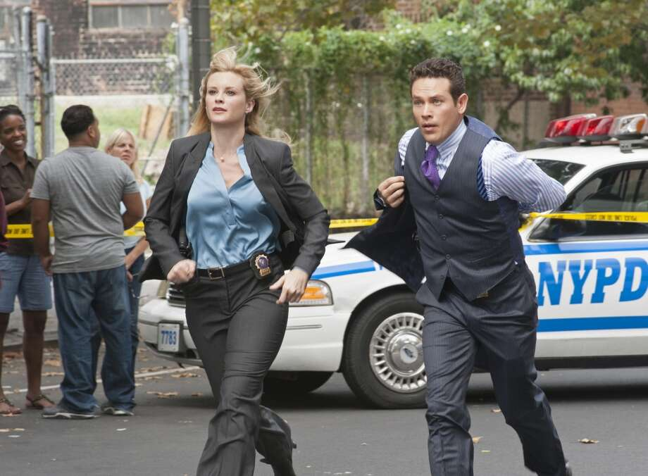 """Role Models"" -- When a police officer who worked with Owen and Arroyo is killed while moonlighting for a rap mogul, Clark is called to investigate. Meanwhile, Clark threatens to expose Arroyo (Kevin Alejandro, right) and McKenzie""™s (Bonnie Somerville, left) relationship, on GOLDEN BOY, Tuesday, March 12 (10:00-11:00 PM, ET/PT) on the CBS Television Network. Photo: CBS Photo Archive, CBS Via Getty Images"