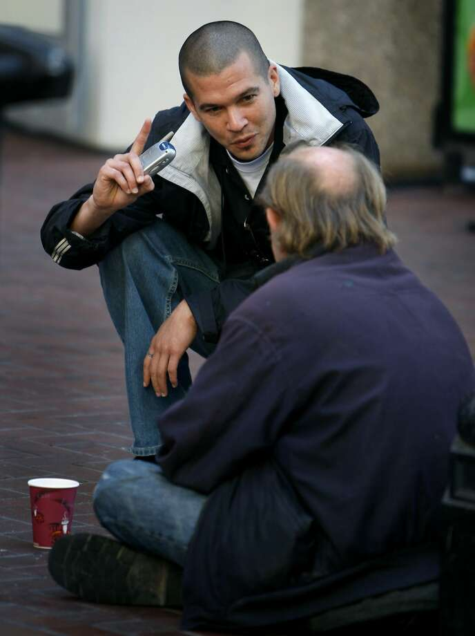 Nickolai Tamanaha, a Homeless Outreach Team case manager, talks with a potential client on Market Street in 2008. Photo: Paul Chinn, The Chronicle