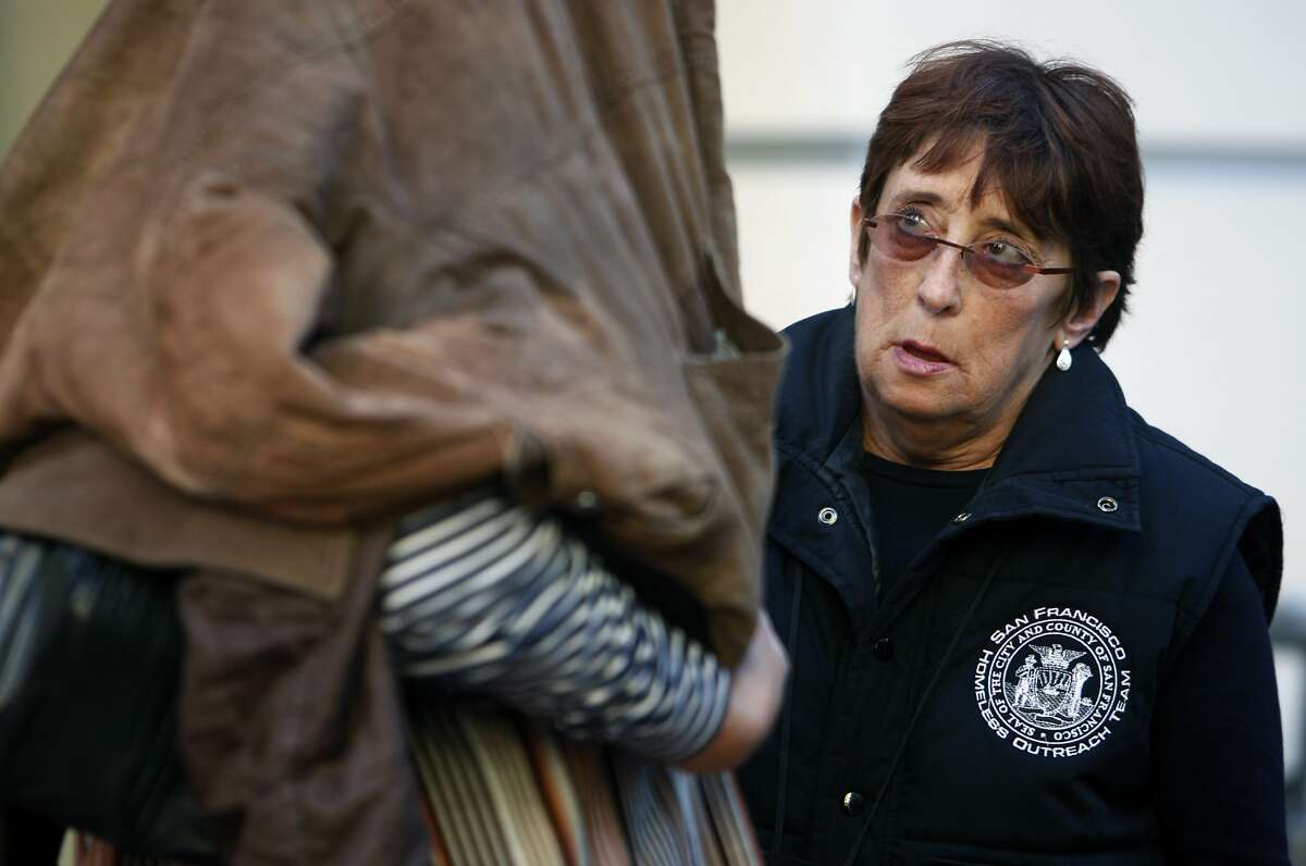 Billie Glendinning tries to convince a homeless woman on Market Street to enter programs offered by the city's Homeless Outreach Team in San Francisco, Calif., on Friday, Sept. 19, 2008.
