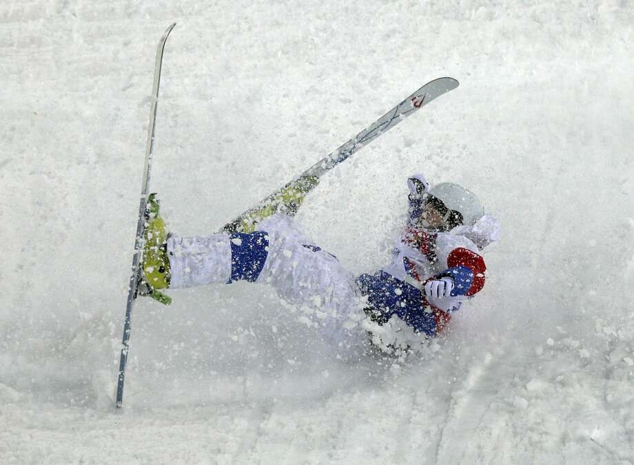 Russia's Sergei Volkov crashes during the men's moguls qualifying at the Rosa Khutor Extreme Park at the 2014 Winter Olympics, Monday, Feb. 10, 2014, in Krasnaya Polyana, Russia. (AP Photo/Andy Wong) Photo: Andy Wong, Associated Press